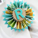 Pretty paper medallion napkin rings made with shower curtain rings. So smart!