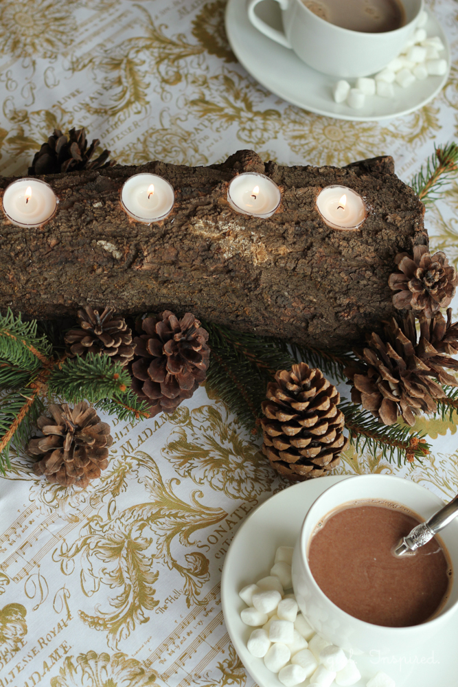 This rustic and chic tealight log centerpiece would be perfect on a holiday table!