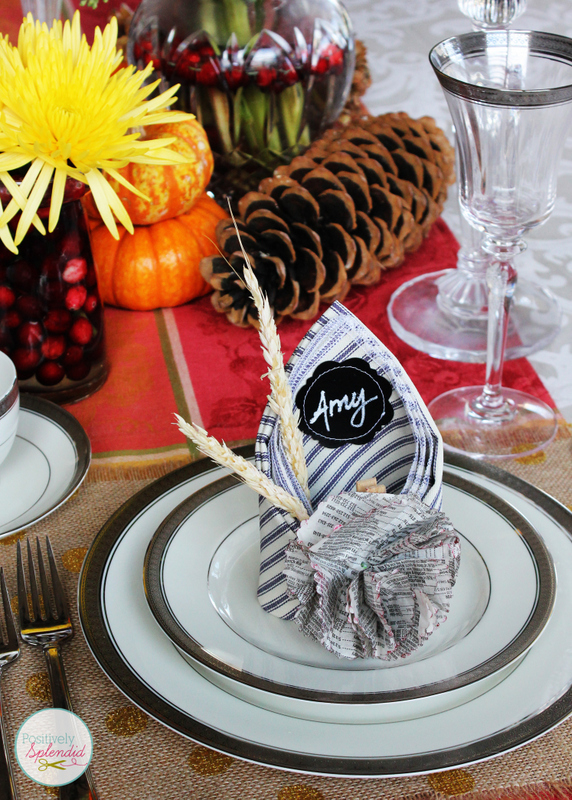 This Thanksgiving table setting at Positively Splendid features creative napkins that double as place cards. Such a great idea!