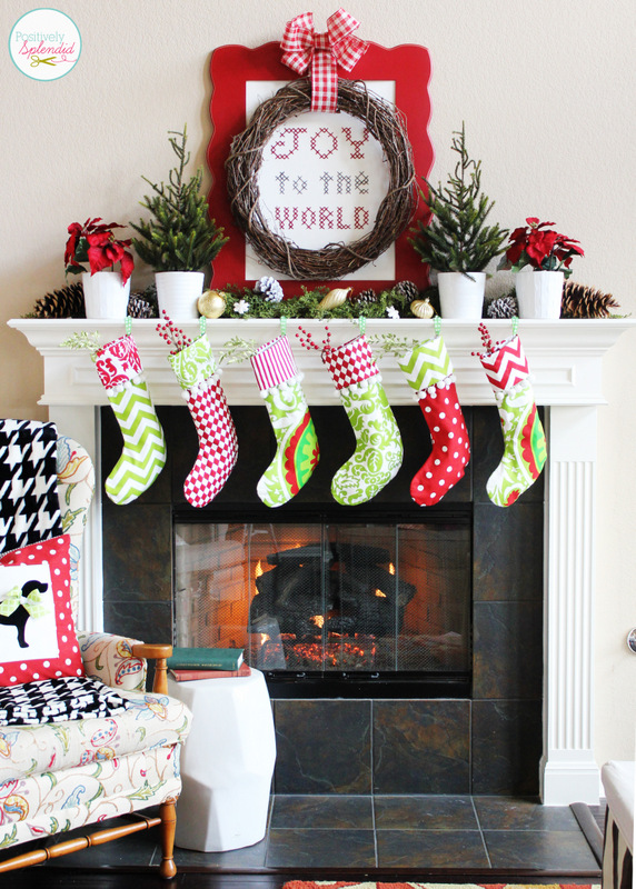 Traditional Christmas Mantel at Positively Splendid, featuring a lovely giant cross-stitch sampler.