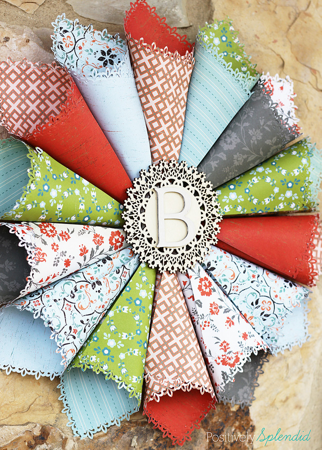 This rolled paper wreath is so pretty, and such a great way to use pretty patterned papers!