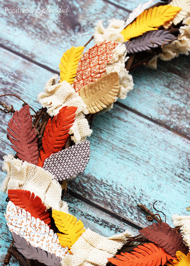 Fall feather wreath made with paper embellishments from the scrapbooking aisle. Easy and fun!