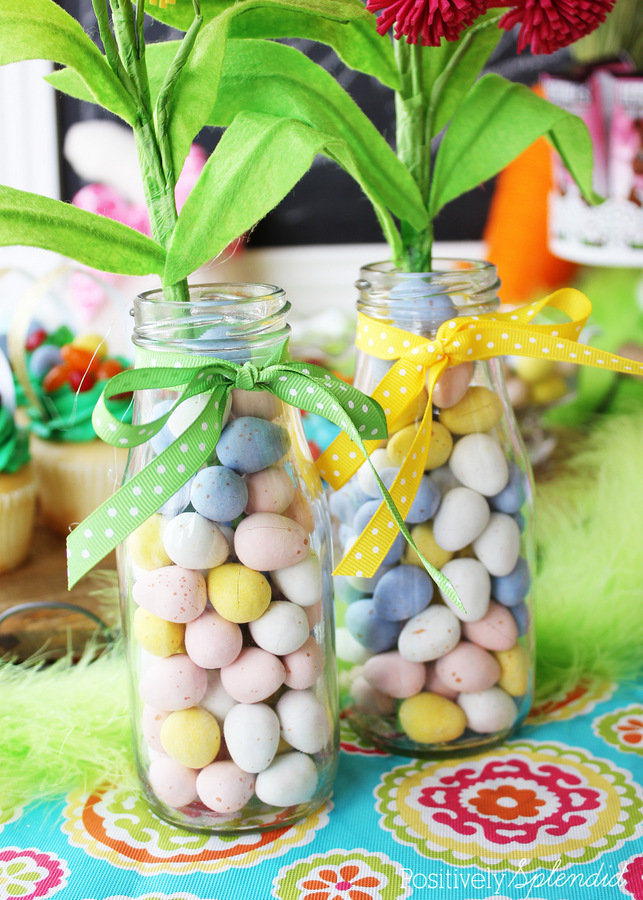 Fill a simple milk bottle with candy for a super easy Easter centerpiece. #HersheysEaster