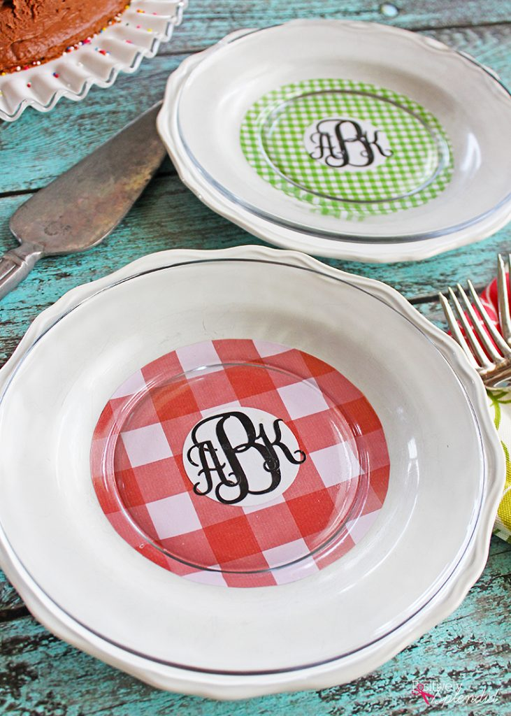 Turn scuffed plates from the thrift store into pretty chargers with scrapbook paper and Mod Podge! #plaidcreators