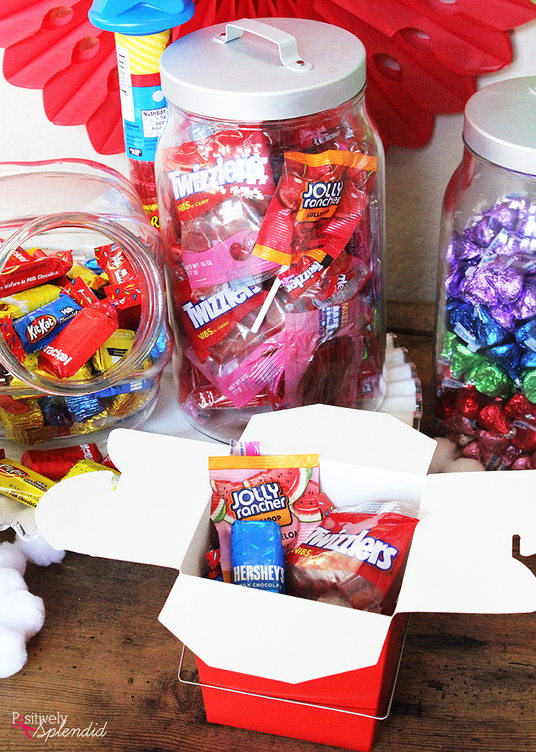 Such a fun kids' birthday party idea! Set up a candy buffet so kids can fill up a box to take home after the party. #LetsBirthday