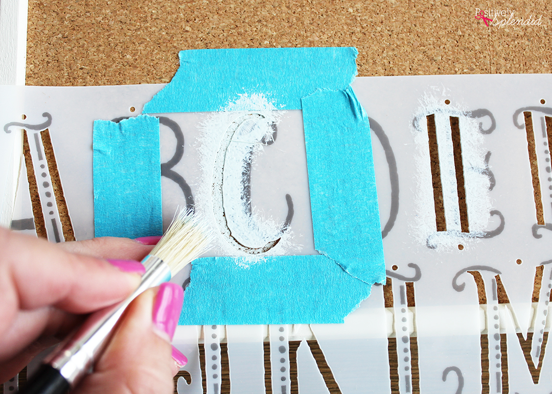Stenciled Bulletin Board - Turn an inexpensive IKEA bulletin board into fun DIY decor for organizing any space!