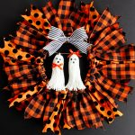 Halloween Ribbon Wreath -- So easy to make with an embroidery hoop, and these ghost tassel embellishments are adorable!